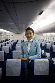 An air hostess of Korean Air poses in an Airbus A380 operated by Korean Air which stands at Vaclav Havel airport on March 14 2014 in Prague Czech...