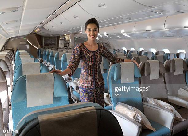 An air hostess poses in the economic class on June 2 2009 in RoissyenFrance northern suburb of Paris in an Airbus A380 after the world's biggest...