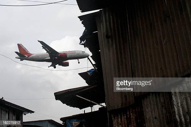 An Air India aircraft prepares to land at Chhatrapati Shivaji International Airport in Mumbai India on Monday Sept 17 2012 India's decision allowing...