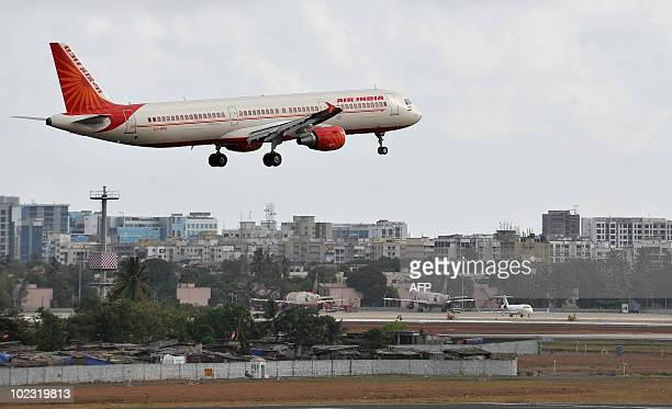 An Air India aircraft prepares to land at the international airport in Mumbai on May 25 2010 Air India staff went on a nationwide flash strike in...