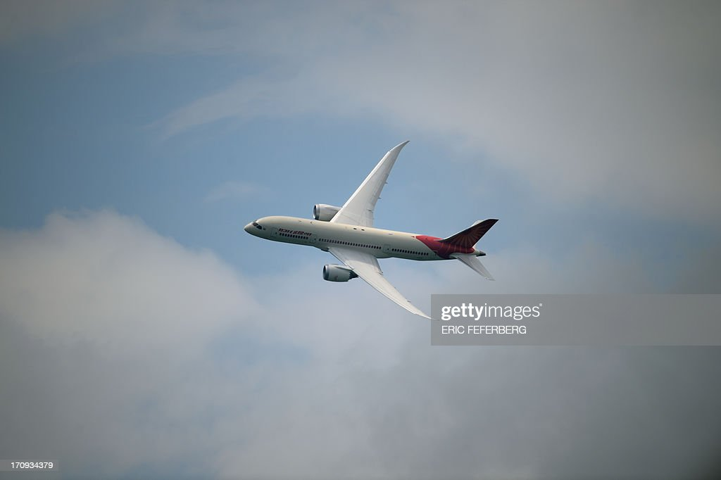 An Air India Boeing Dreamliner flies over Le Bourget airport, near Paris on June 20, 2013 during the 50th International Paris Air show.