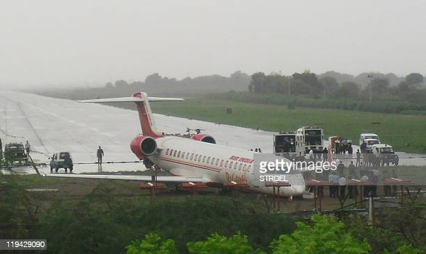 An Air India CRJ700 regional jet is seen after it skidded off the runway following a tyre burst while landing at Kanpur airport on July 20 2011 An...