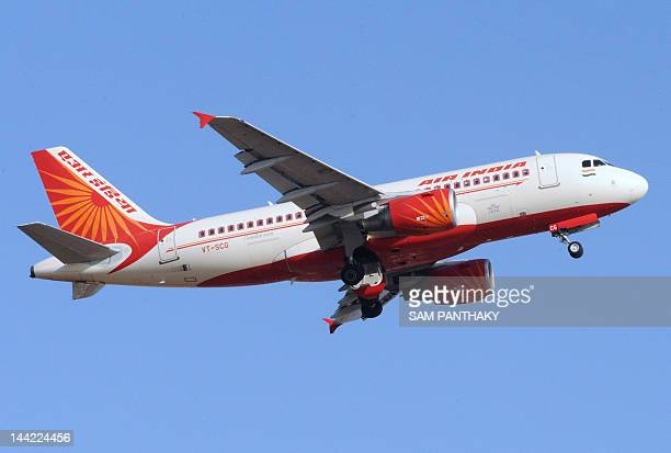 An Air India domestic flight takes off from Sardar Vallabhbhai International Airport in Ahmedabad on May 12 2012 National carrier Air India fired 25...