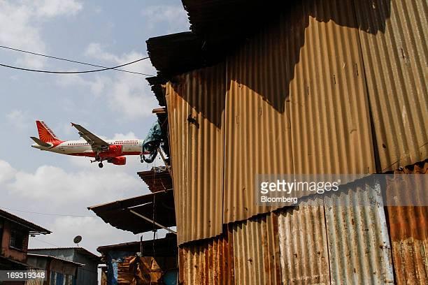 An Air India Ltd aircraft prepares to land at Chhatrapati Shivaji International Airport in Mumbai India on Thursday May 23 2013 Air India is the...