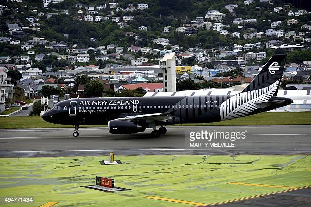 An Air New Zealand Airbus A320 designed with the New Zealand All Blacks rugby team colours is seen at the airport in Wellington on October 29 ahead...