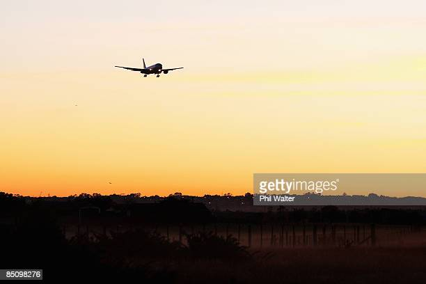 An Air New Zealand jet comes into land at Auckland International Airport at dawn on February 26 2009 in Auckland New Zealand Air New Zealand today...