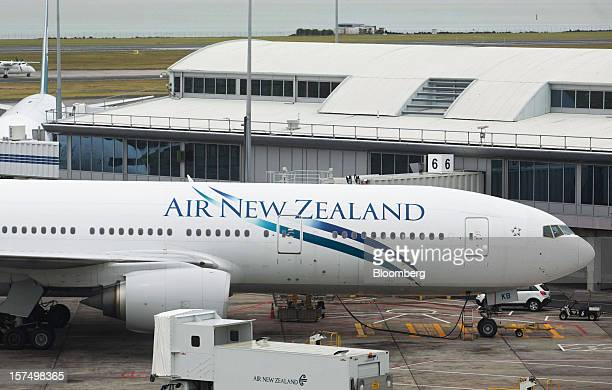 An Air New Zealand Ltd aircraft stands on the tarmac at Auckland International Airport in Auckland New Zealand on Tuesday Dec 4 2012 Auckland...