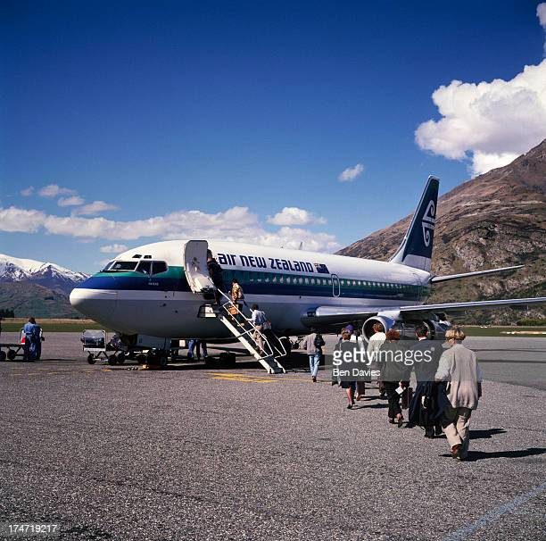 An Air New Zealand Plane on the tarmac at Queenstown Airport situated close to the scenic Lake Wakatipu on New Zealand's South Island Surrounded by...