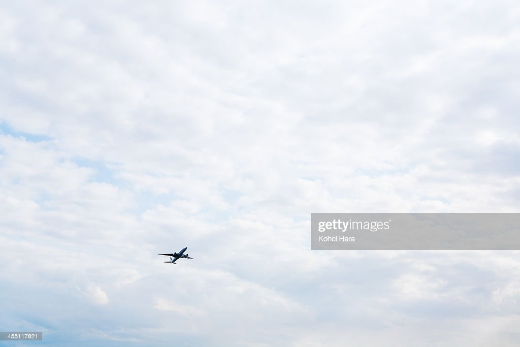 an air plane flying in the sky : Stock Photo