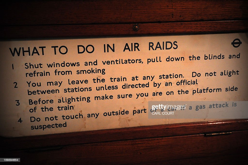 An air raid warning sign is pictured on steam train which used to carry passengers in the 19th century as it arrived at Moorgate Underground Station in central London on January 13, 2013, to mark 150 years since the first London underground journey. AFP PHOTO / CARL COURT