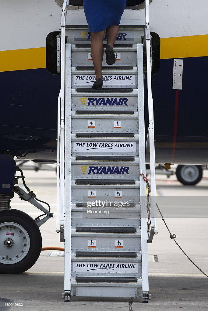 An air stewardess climbs the steps to board a Ryanair Holdings Plc passenger aircraft at Stansted Airport, operated by Manchester Airports Group (MAG) in Stansted, U.K., on Tuesday, Sept. 10, 2013. From two planes in 1995, EasyJet has grown to more than 200 Airbus SAS aircraft carrying more than 59 million people annually, 20 million fewer than Ryanair. Photographer: Simon Dawson/Bloomberg via Getty Images