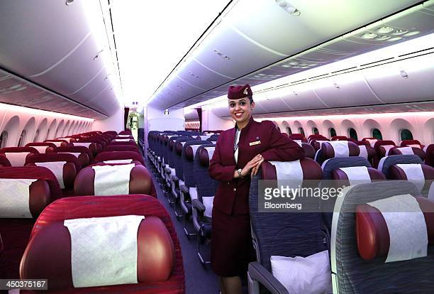 An air stewardess for Qatar Airways Ltd stands in the economy cabin aboard a Boeing 787 Dreamliner aircraft operated by Qatar Airways Ltd...