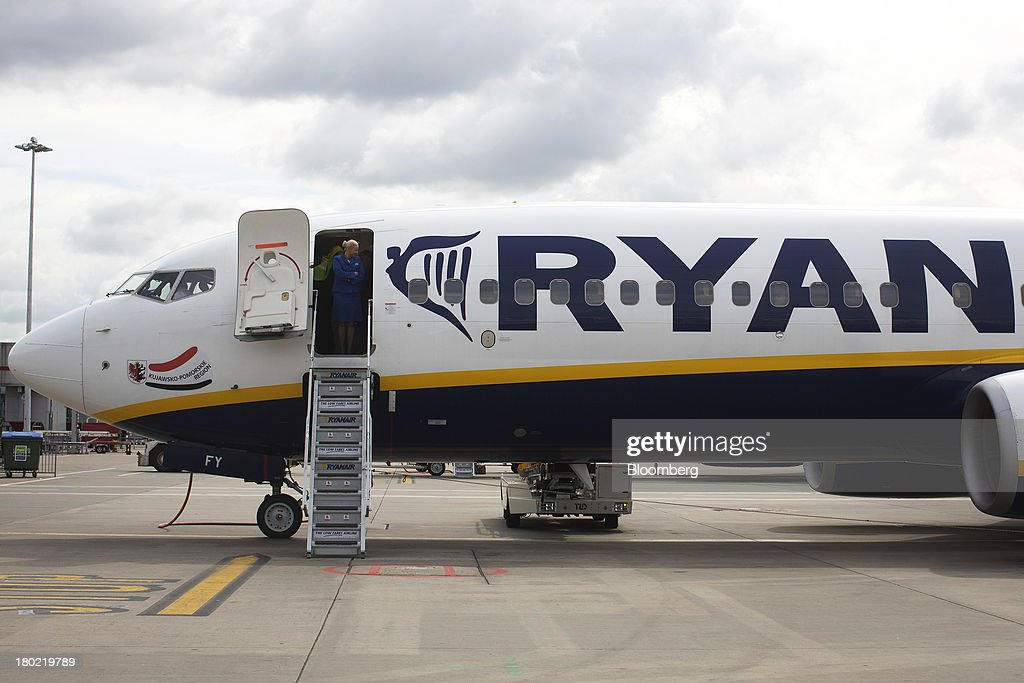 An air stewardess stands onboard a Ryanair Holdings Plc passenger aircraft as it sits on the tarmac at Stansted Airport, operated by Manchester Airports Group (MAG) in Stansted, U.K., on Tuesday, Sept. 10, 2013. From two planes in 1995, EasyJet has grown to more than 200 Airbus SAS aircraft carrying more than 59 million people annually, 20 million fewer than Ryanair. Photographer: Simon Dawson/Bloomberg via Getty Images