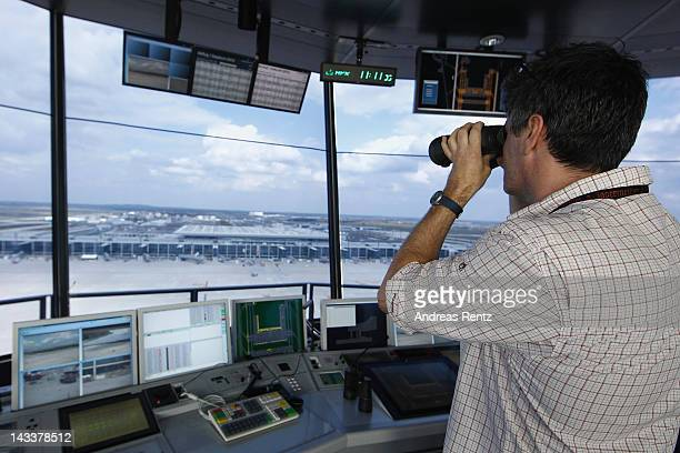 An air traffic controller looks out onto the tarmac following the official inauguration of the new control tower at Willy Brandt Berlin Brandenburg...