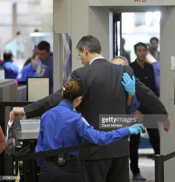 An air traveler is patted down after passing through a fullbody scanner at Los Angeles International Airport on February 20 2014 in Los Angeles...