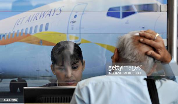 An air traveller reacts while waiting at the Jet Airways counter at the city airport in Mumbai on September 8 2009 Flights on India's secondlargest...