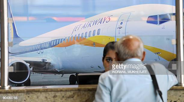 An air traveller waits at the Jet Airways counter at the city airport in Mumbai on September 8 2009 Flights on India's secondlargest private airline...