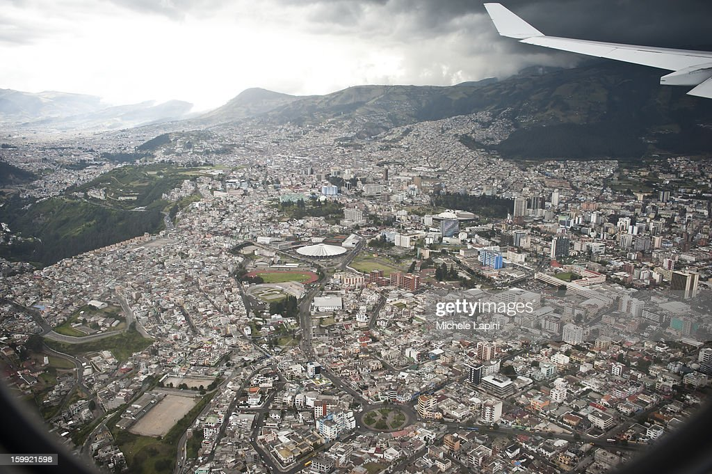 CONTENT] An air view of Quito from the airplane. The Capital of Ecuador is an elevation of 9,350 feet (2,800 meters), it is the highest capital city in the world housing the administrative, legislative and judicial functions.