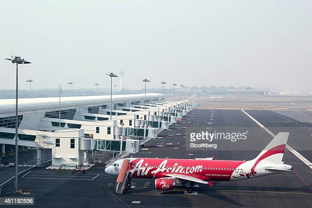 An AirAsia Bhd aircraft stands on the tarmac at Kuala Lumpur International Airport 2 in Sepang Malaysia on Tuesday June 24 2014 KLIA2 will provide...