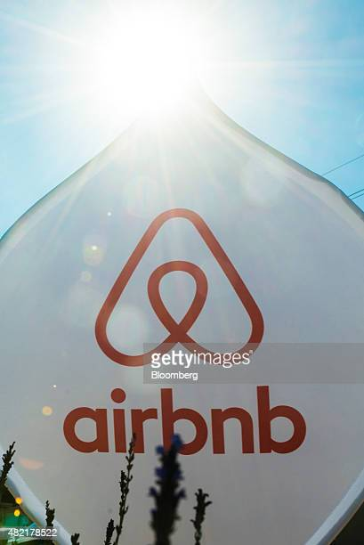 An Airbnb Inc logo sits on a banner displayed outside a media event in Johannesburg South Africa on Monday July 27 2015 Airbnb is hoping to spread...