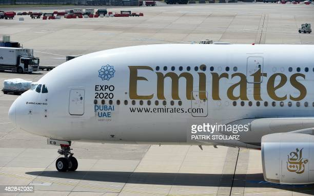 An Airbus A 380 of airline 'Emirates' roll on the runway on August 3 2015 in Duesseldorf western Germany AFP PHOTO / PATRIK STOLLARZ
