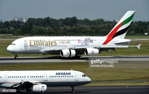 An Airbus A 380 of airline 'Emirates' rolls on the runway on August 3 2015 in Duesseldorf western Germany AFP PHOTO / PATRIK STOLLARZ