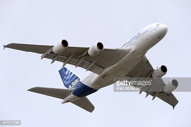 An Airbus A 380 performs at Le Bourget airport near Paris on June 15 2015 the 51st International Paris Airshow AFP PHOTO /ERIC PIERMONT