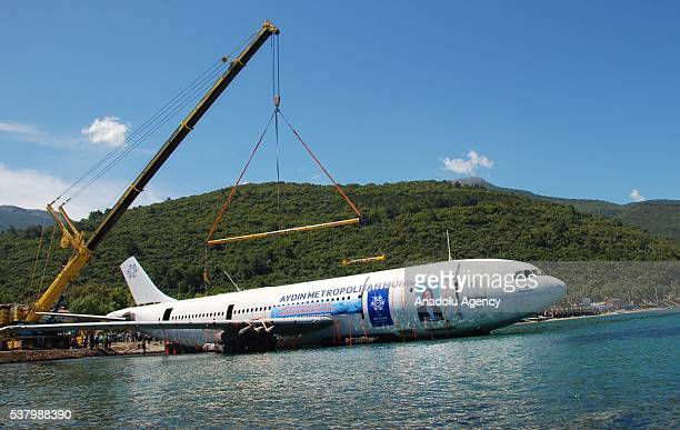 An Airbus A300 plane is seen as it will be sunk in the waters of the Aegean Sea off the coast of Kusadasi near Turkey's Izmir province on June 04...