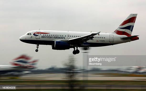 An Airbus A319 aircraft operated by British Airways passes Terminal 5 as it prepares to land at Heathrow Airport in London UK on Thursday Feb 28 2013...