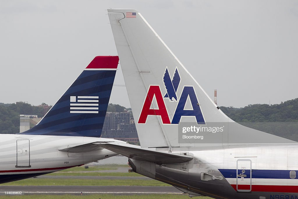 An Airbus A319, operated by US Airways Group Inc., left, taxis after landing behind a Boeing Co. 737, operated by AMR Corp.'s American Airlines, at Reagan National Airport in Washington, D.C., U.S., on Tuesday, May 8, 2012. American Airlines gave more details of its strategy as US Airways Group Inc. steps up pressure for a possible takeover bid. Photographer: Andrew Harrer/Bloomberg via Getty Images
