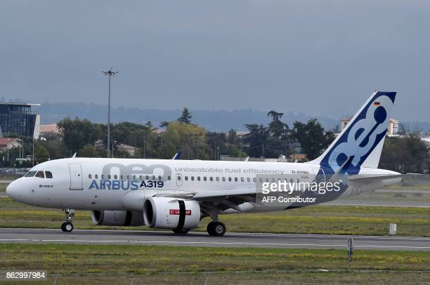 An Airbus A319neo is parked on the tarmac of the ToulouseBlagnac airport near Toulouse on October 19 2017 / AFP PHOTO / PASCAL PAVANI