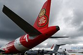An Airbus A320 aircraft is seen beside the runway during the Farnborough Airshow south west of London on July 12 2016 German airline Germania on...