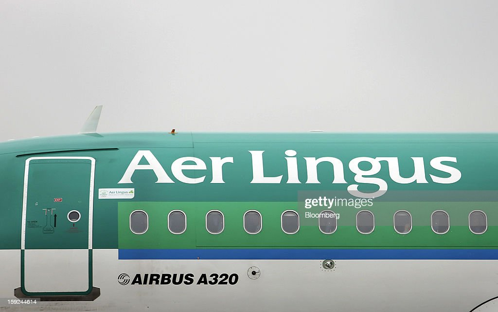 An Airbus A320 aircraft, operated by Aer Lingus Group Plc, sits on the tarmac at Gatwick airport in Crawley, U.K., on Thursday, Jan. 10, 2013. Gatwick, acquired by Global Infrastructure Partners Ltd. in 2009 after regulators sought a breakup of BAA Ltd., owner of the larger Heathrow hub, is 30 miles (48 kilometers) south of London and serves about 200 destinations, more than any other U.K. airport, according to flight schedule data provider OAG. Photographer: Chris Ratcliffe/Bloomberg via Getty Images