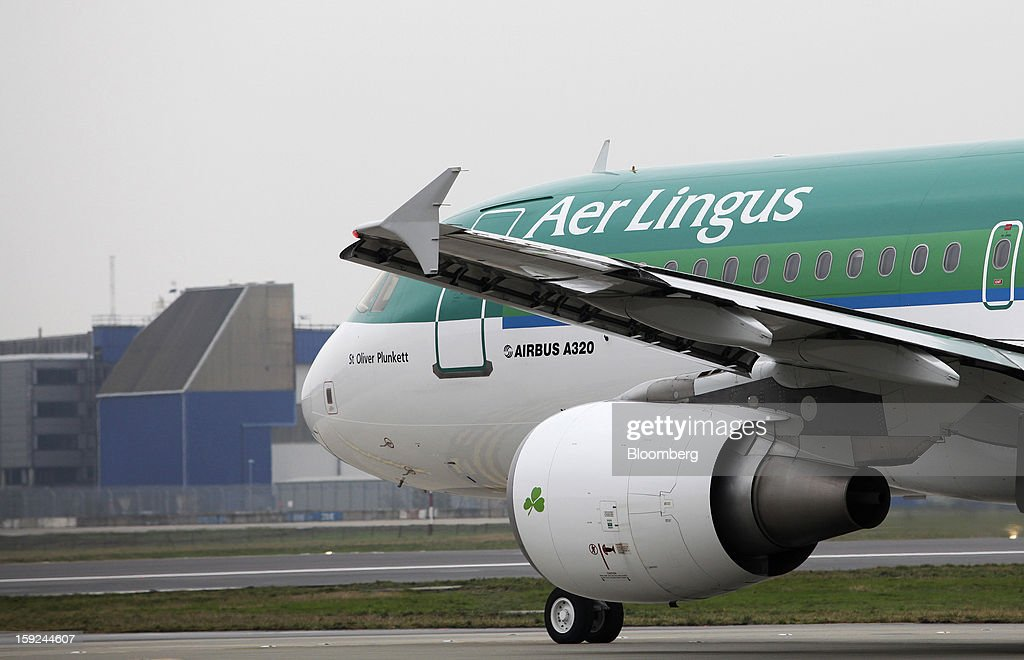 An Airbus A320 aircraft, operated by Aer Lingus Group Plc, taxis towards the runway at Gatwick airport in Crawley, U.K., Thursday, Jan. 10, 2013. Gatwick, acquired by Global Infrastructure Partners Ltd. in 2009 after regulators sought a breakup of BAA Ltd., owner of the larger Heathrow hub, is 30 miles (48 kilometers) south of London and serves about 200 destinations, more than any other U.K. airport, according to flight schedule data provider OAG. Photographer: Chris Ratcliffe/Bloomberg via Getty Images