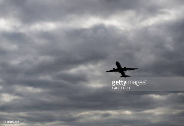An Airbus A320 airplane takes off from a runway at Ronald Reagan Washington National Airport in Arlington Virginia September 23 2013 AFP PHOTO / Saul...