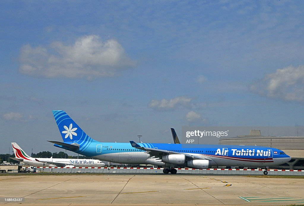 An Airbus A340 of Air Tahiti Nui airline is seen on taxiways prior to take off at Paris Roissy Charles de Gaulle airport in Roissy-en-France, north of Paris on July 18, 2012.