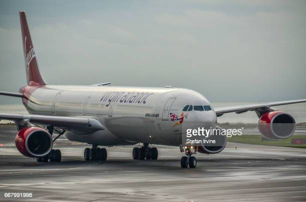 An Airbus A340600 operated by Virgin Atlantic advancing on the taxiway after touching down at Hong Kong International Airport