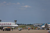 An Airbus A350 aircraft operated by Qatar Airways Ltd left stands on the taxiway during preparations ahead of opening at the 51st International Paris...