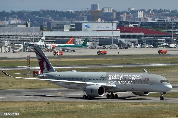 An Airbus A350 of Qatar Airlines lands at the ToulouseBlaignac airport on June 16 2017 / AFP PHOTO / REMY GABALDA