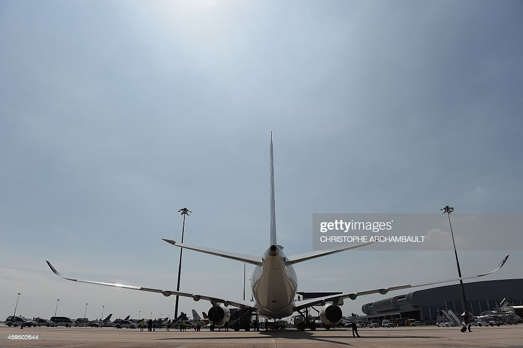 An Airbus A350 XWB is seen parked at a technical area after landing at Suvarnabhumi International Airport in Bangkok on November 24 2014 on the Thai...