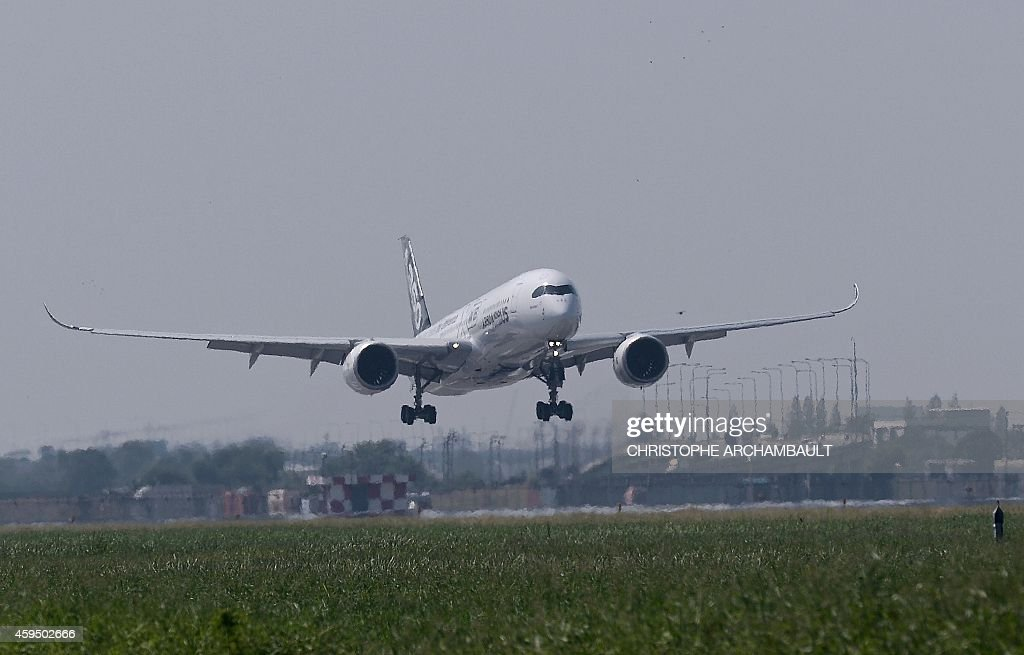 An Airbus A350 XWB lands at Suvarnabhumi International Airport in Bangkok on November 24 2014 on the Thai leg of the airliner's demonstration tour of...