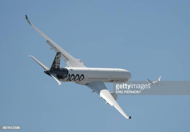 An Airbus A3501000 XWB performs a flight display at Le Bourget airport on June 19 2017 on the opening day of the International Paris Air Show / AFP...