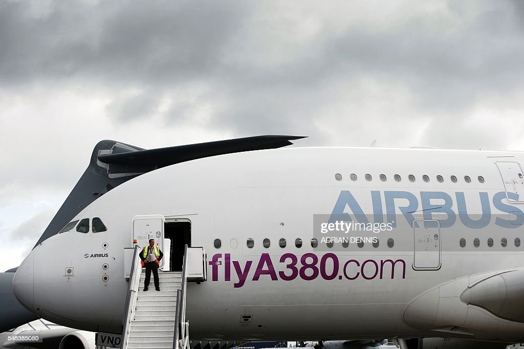 An Airbus A380 aircraft is seen beside the runway during the Farnborough Airshow south west of London on July 12 2016 German airline Germania on...