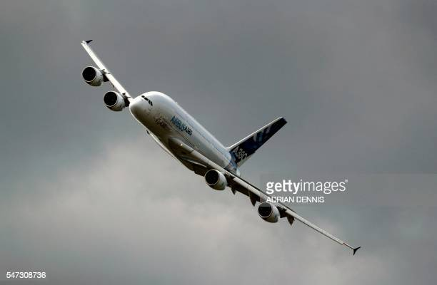 An Airbus A380 aircraft performs during a flying display at the Farnborough Airshow south west of London on July 14 2016 The event held every two...