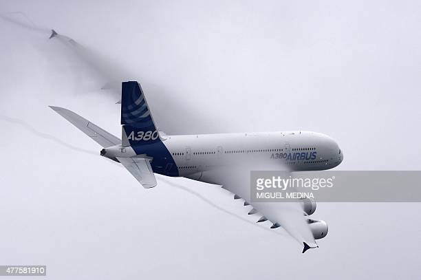 An Airbus A380 airplane performs at the International Paris Airshow in Le Bourget on June 18 2015 The airshow will be open to the general public from...