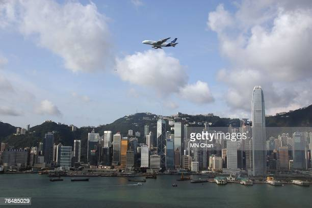 An Airbus A380 flies over Hong Kong's Victoria Harbour on September 3 2007 in Hong Kong China The A380 is the largest passenger airliner with a...