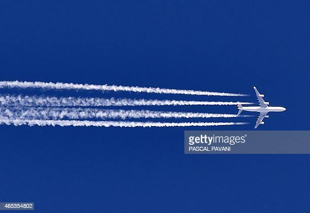 An Airbus A380 flies over the Sivens forest in the department of Tarn southwestern France on March 6 2015 AFP PHOTO / PASCAL PAVANI