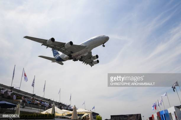 An Airbus A380 jet airliner prepares to land during the International Paris Air Show at Le Bourget north of Paris on June 20 2017 / AFP PHOTO /...