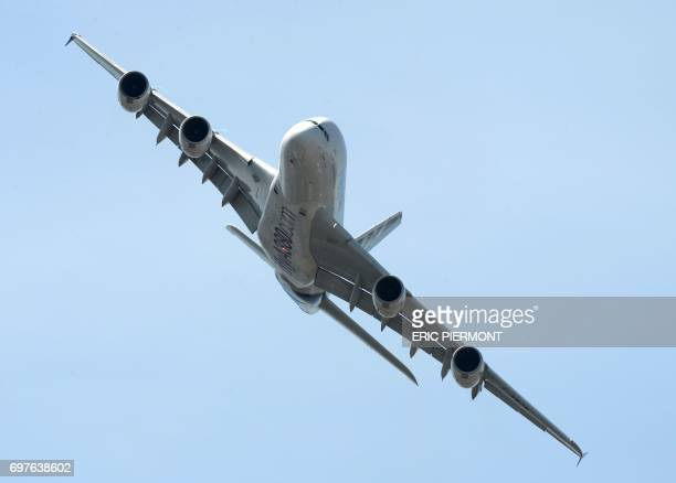 An Airbus A380 performs a flight display at Le Bourget airport on June 19 2017 on the opening day of the International Paris Air Show / AFP PHOTO /...