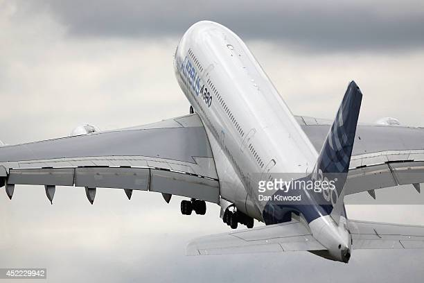 An Airbus A380 performs in an aerial flying display on day four of the Farnborough International Airshow on July 16 2014 in Farnborough England The...